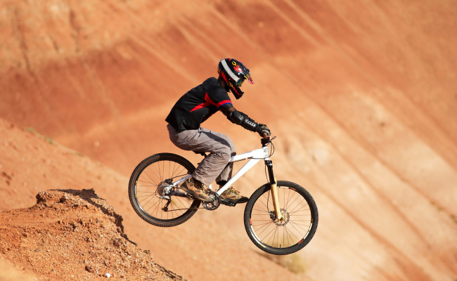 Extreme biker in red canyon